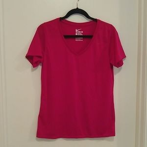 The Nike tee dry fit athletic cut raspberry color